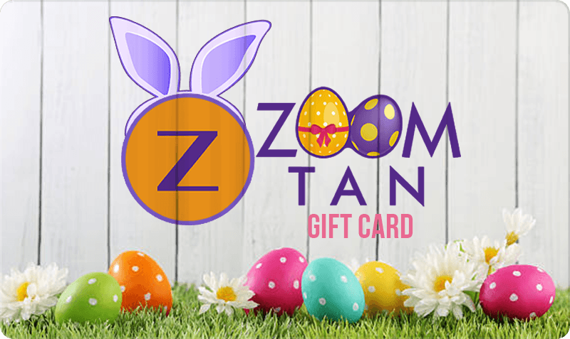 Easter/Spring Gift Card - Zoom tan logo with bunny ears, easter eggs, green grass and white fence background
